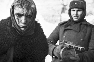A German prisoner of war escorted by a Soviet soldier, Stalingrad, 1943