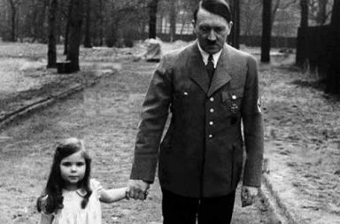 Adolf Hitler on a walk with Helga Goebbels, 1936