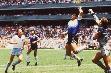 Diego Maradona scores the infamous Hand of God goal, 1986