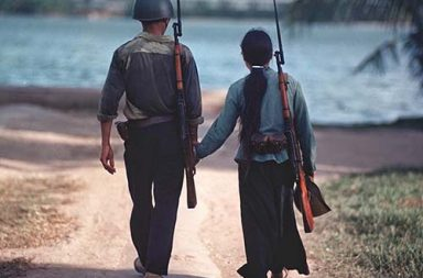 A couple of warriors holding hands, Vietnam, 1971
