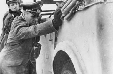 Erwin Rommel helps to push his stuck staff car somewhere in Northern Africa, 1941