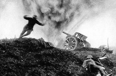 German soldier dives for cover as shell explodes behind him at an artillery position, 1917