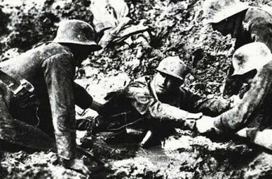 German troops trying to rescue a French soldier from sinking in a mud hole, 1918