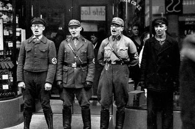 Nazis singing to encourage a boycott of Jewish shops , 1933