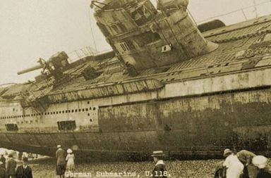 U-118, a World War One submarine washed ashore on the beach at Hastings, 1919