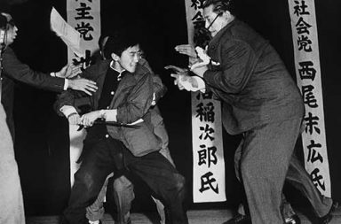Using a traditional Japanese blade, 17-year-old Yamaguchi assassinates politician Asanuma in Tokyo, 1960