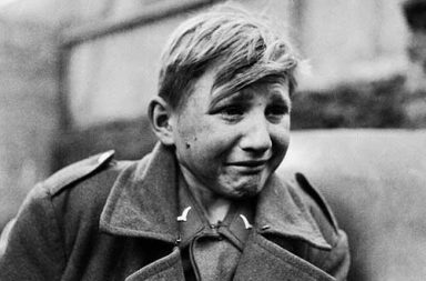 Hans-Georg Henke - 16 year old German soldier crying after being captured by the Allies, 1945