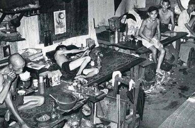Opium den in Singapore, 1941