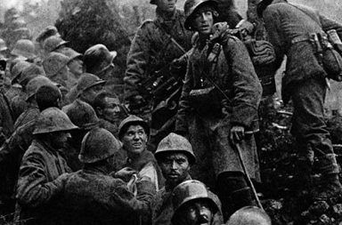 Captured Italian soldiers are escorted to the rear by German soldiers during the Battle of Caporetto, 1917