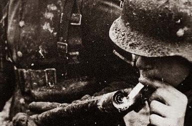 German soldier lighting his cigarette with a flamethrower, 1917