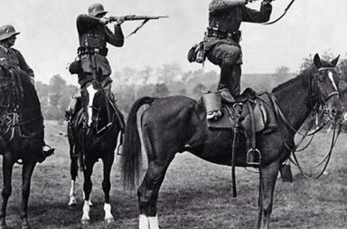 German soldiers take aim from the backs of horses, mid-1930