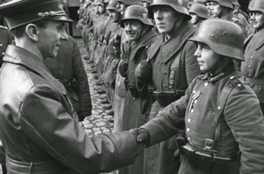 Goebbels congratulates a young recruit after receiving the Iron Cross II, 1945