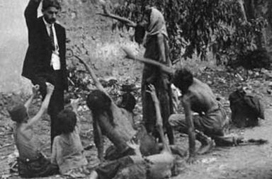 A Turkish official taunting starving Armenians with bread, 1915