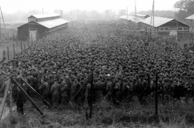 German prisoners of war packed into the Nonant le Pin prisoner camp, 1944