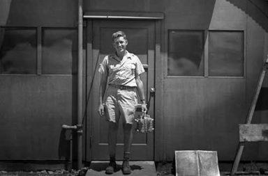 Harold Agnew carrying the plutonium core of the Nagasaki Fat Man bomb, 1945