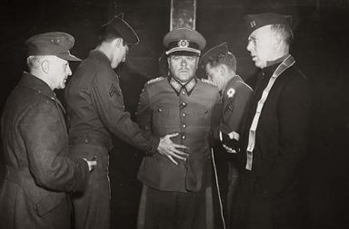 Nazi General Anton Dostler is tied to a stake before his execution by a firing squad, Italy, 1945