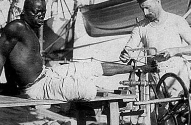 Slave shackle being removed by British sailor, 1907