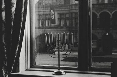 A menorah defies the Nazi flag, 1931