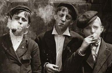 Child laborers, newsboys smoking cigarettes, 1910