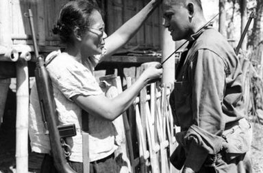 Captain Nieves Fernandez shows to an American soldier how she used her long knife to silently kill Japanese soldiers during occupation, 1944.