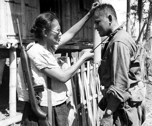 Captain Nieves Fernandez Shows To An American Soldier How