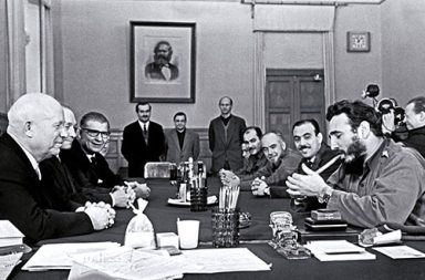 Fidel Castro lighting a cigar and wearing two Rolex watches during a meeting with Khrushchev, Kremlin, 1963