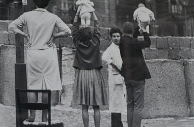 Residents of West Berlin show children to their grandparents who reside on the Eastern side, 1961