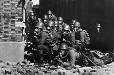 Japanese Special Naval Landing Forces with gas masks and rubber gloves during a chemical attack, Battle of Shanghai, 1937
