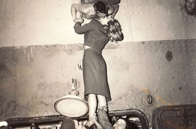 Actress Marlene Dietrich kisses a soldier returning home from war, 1945