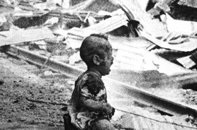 Bloody Saturday - a crying Chinese baby amid the bombed-out ruins of Shanghai's South Railway Station, 1937