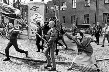 A woman hitting a neo-Nazi with her handbag, Sweden, 1985