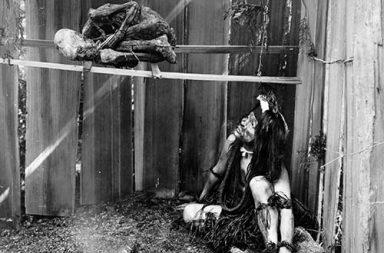 Native American smoke curing a human corpse, 1910