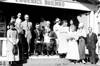 Winning family of the Fittest Family award stand outside of the Eugenics Building, 1925