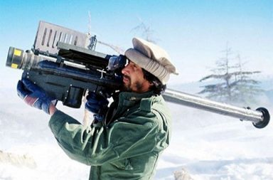 A Mujahideen fighter aims an FIM-92 Stinger missile at passing aircraft, Afghanistan, 1988