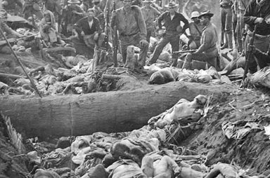 US soldiers pose with the bodies of Moro insurgents, Philippines, 1906