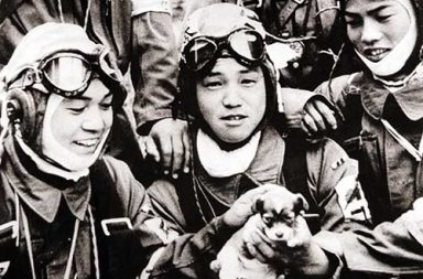 Kamikaze pilots posing with a puppy on the day before their suicide missions, 1945