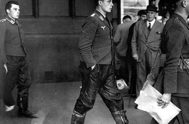 Under British military escort, two captured Luftwaffe crewmen, walk out of the London Underground, 1940