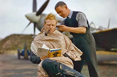 RAF pilot getting a haircut during a break between missions, 1942