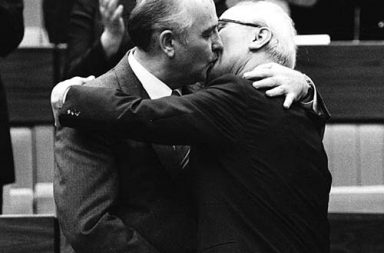 Mikhail Gorbachev congratulates East German leader Erich Honecker with a fraternal hug and kiss after Honecker's re-election as the head of the Communist Party, 1986
