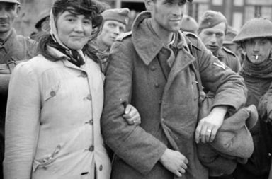 A Dutch woman entering military captivity with her husband, a German soldier, 1944
