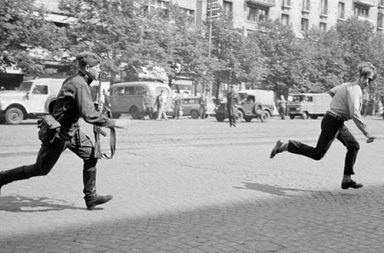 The Prague Spring of 1968: Soviet soldier chasing young man who had thrown stones at a tank.