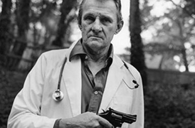 Dr. John Britton with the .357 Magnum he carried for protection when visiting the Pensacola Ladies' Centre to perform abortions, 1993