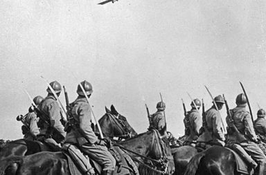 French cavalry with a plane flying overhead, 1916
