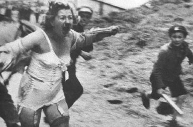 Jewish woman chased by men and youth armed with clubs during the Lviv pogroms, 1941