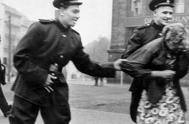 Soviet soldiers openly sexually harass a German woman in Leipzig, 1945