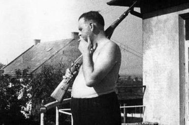 "Camp Commandant Amon Goeth, infamous from the movie ""Schindler's List"", standing on his balcony preparing to shoot prisoners, 1943-1944"