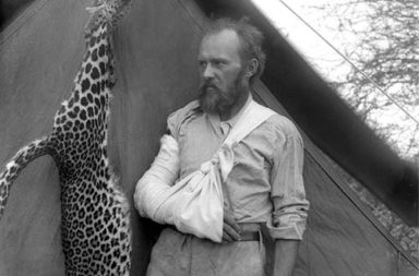 Taxidermist Carl Akeley posing with the leopard he killed with his bare hands after it attacked him, 1896