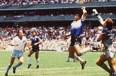 Diego Maradona scores the infamous Hand of God goal, 1986