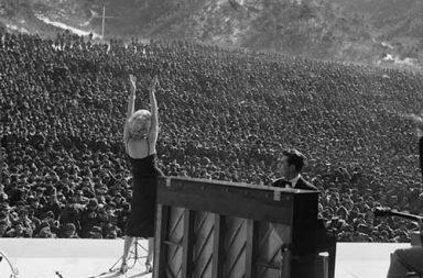 Marilyn Monroe performing for the thousands of allied troops in Korea, 1954