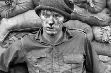 Private Heath Matthews waiting for medical attention after a raid on enemy positions during the Korean War, 1952